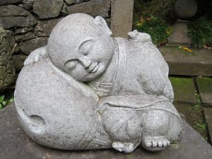 Asleep fat Buddha