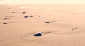 Stones on sand